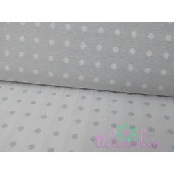 Jacquard gris pálido con topo blanco
