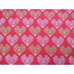 Tela de  algodón estampado navideño corazones f. rojo