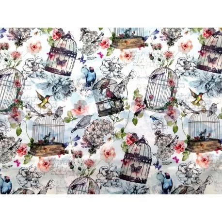 Tela de  algodón con flores y pájaros en celeste