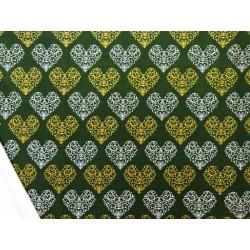 Tela de  algodón estampado navideño corazones f. verde